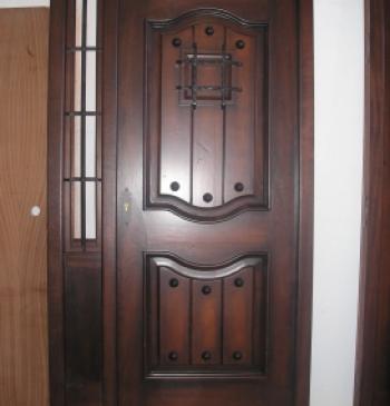 Puerta exterior en madera de iroko doble hoja www for Puerta doble hoja exterior